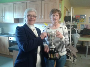 Heather Clements presenting the RJ Monteith Perpetual Cup to Ann Regan