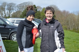 Debbie Butler 75cm class winner receiving prize money and rosette from Hazel Kelly representating RA Kelly Electrical Contractor Class sponsor