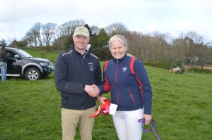 Lisa Boyle 95cm class winner receiving prize money and rosette from  Farrier Lee Johnston class sponsor